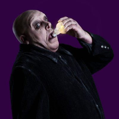Les Dennis as Uncle Fester